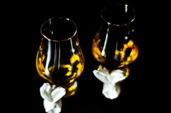 Single malt whiskey in a glass of tasting with napkin bunny, fes. Tive Easter decoration, holiday Royalty Free Stock Photography