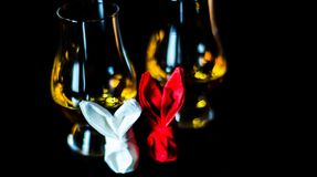 Single malt whiskey in a glass of tasting with napkin bunny, fes. Tive Easter decoration, holiday Stock Photo