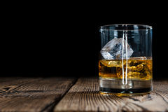 Single Malt Whiskey. With Ice Cubes on wooden background Stock Photo