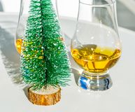 Single malt whisky  in the glass with decorative Christmas tree, Royalty Free Stock Photo