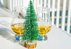 Single malt whisky  in the glass with decorative Christmas tree, Stock Image