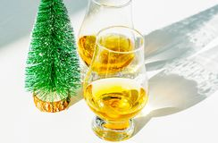 Single malt whisky  in the glass with decorative Christmas tree, Stock Photo