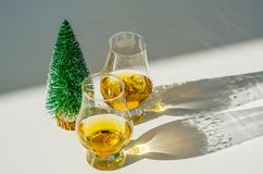 Single malt whisky  in the glass with decorative Christmas tree, Royalty Free Stock Photos