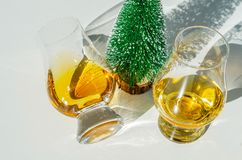 Single malt whisky  in the glass with decorative Christmas tree, Royalty Free Stock Images