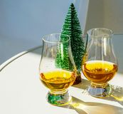 Single malt whisky  in the glass with decorative Christmas tree, Stock Photography