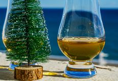 Single malt whisky  in the glass with decorative Christmas tree, Royalty Free Stock Photography