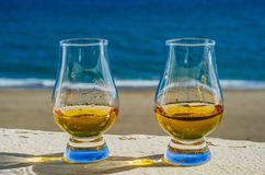 Single malt whisky  in the glass, luxurious tasting glass Royalty Free Stock Photos