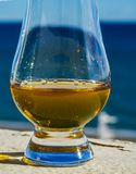 Single malt whisky  in the glass, luxurious tasting glass Royalty Free Stock Images