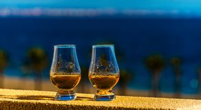 Single malt whisky in the glass, luxurious tasting glass. Tasty set royalty free stock images