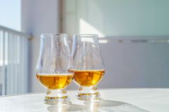 Single malt whisky  in the glass, luxurious tasting glass Stock Image