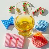 Single malt whisky in the glass with rubber letters, xmas inscr. Iption, luxurious tasting glass, drink set royalty free stock images