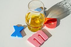 Single malt whisky in the glass with rubber letters, xmas inscr. Iption, luxurious tasting glass, drink set stock photos