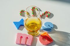 Single malt whisky in the glass with rubber letters, xmas inscr. Iption, luxurious tasting glass, drink set stock photography