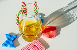 Single malt whisky in the glass with rubber letters, xmas inscr. Iption, luxurious tasting glass, drink set stock photo