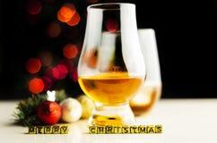 Single malt whisky in tasting glass on christmas background, co. Lorful bokeh, xmas time stock image