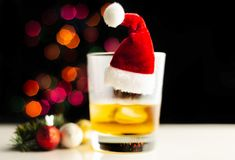 Single malt whisky in tasting glass on christmas background, co. Lorful bokeh, xmas time stock photography