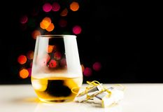 Single malt whisky in tasting glass on christmas background, co. Lorful bokeh, xmas time royalty free stock images