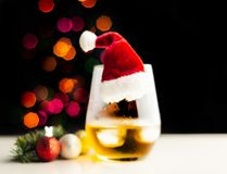 Single malt whisky in tasting glass on christmas background, co. Lorful bokeh, xmas time stock photo