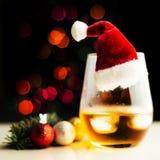 Single malt whisky in tasting glass on christmas background, co. Lorful bokeh, xmas time stock photos