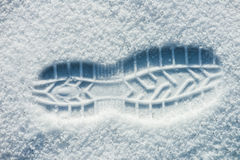 Single man's footprint on the fresh fluffy snow. This is an top view image of single man's footprint on the fresh and fluffy white  snow. The texture  of Royalty Free Stock Photography
