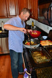 Single man cooking. Chicken vegetables Royalty Free Stock Images