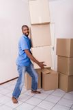 Single man moving. Young single african american man moving to new home Stock Photography