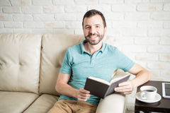 Man enjoying an afternoon of coffee and reading stock images