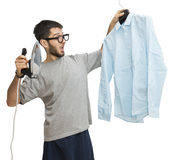 Single man scared about ironing Stock Photography
