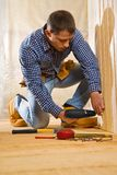 Single man work in the wooden room Royalty Free Stock Images