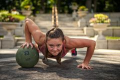 Single medicine ball push-ups Stock Images