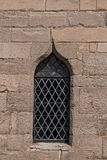 Single medieval castle stained glass window detail close up view.  royalty free stock photo