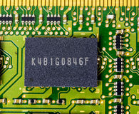 Single memory chip on a computer board. Close up of computer electronics stock photos