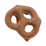 Single milk chocolate covered covered pretzel Stock Photos