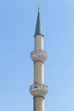 Single minaret in clear sky. Photograph of single minaret of mosque Stock Photo