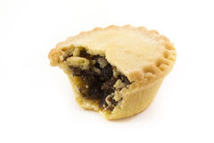 Single mince pie with a bite taken. Single mince pie with a missing bite Royalty Free Stock Photo