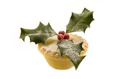 Single mince pie decorated with holly. Over white Royalty Free Stock Photos