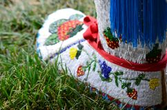 A single moccasin with beautiful handcrafted colorful bead work royalty free stock photos