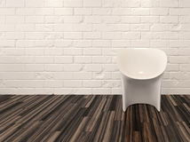 Single modern white chair against a brick wall Stock Image
