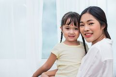 Single mom and daughter portrait. Happy family and people concept. Mother and Children day theme. Single mom and daughter portrait. Happy family and people royalty free stock photography