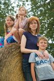 Single Mom Family. A single mom family portrait on hay bales stock photography