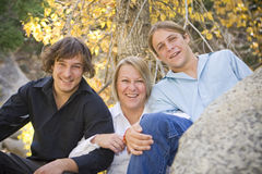 Single Mom with her Teenage Boys 2. Photo of single mom with her two teenage boys. Warm tones with fall background Stock Images