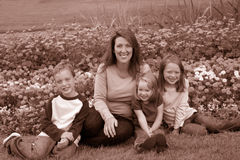 Single mom and kids. A family three young children and a single mother Stock Photos