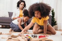 Free Single Mom With Two Daughter Playing Toy In Apartment. Nanny Looking Or Childcare At Home Black People Stock Photos - 177664323