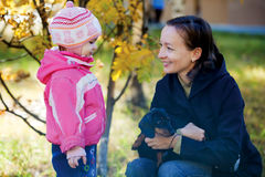 Single Mother Family Portrait. A family portrait of a single mom, her daughter and  dog set in a beautiful autumn forest Stock Photography