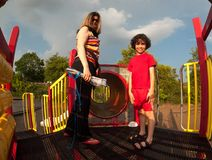 Single mother and her child in a park Stock Images