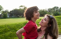 Single mother and her child in a park. Single mother spending time with her son in a park royalty free stock image