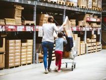 Single mother shopping at IKEA furniture store pushing cart stock photos