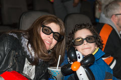 Single Mother and son at the movies Royalty Free Stock Photography