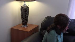 Single Mother and son playing in the living room stock footage