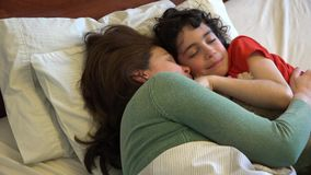 Single Mother and son sleeping together Royalty Free Stock Photos